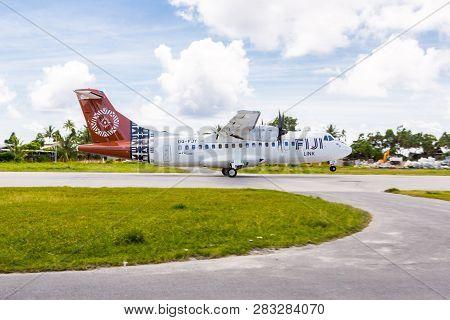 Vaiaku Village, Tuvalu - Dec 27, 2014: Fiji Link Atr 42-600 Airplane Departing From Tuvalu Internati