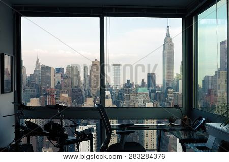 View Of Skyscrapers Of  New York City (manhattan) Through Windows Of Apartment. Top View Of Midtown