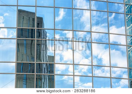 Abstract Architecture Background. Sky And Buildings Are Reflected In The Office Skyscraper Facade. C