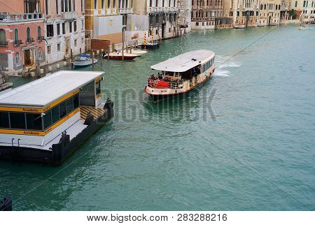 Venice, Italy - December 28 2009: A Waterbus Called Vaporetto In Italian Mooring At The Station Acca