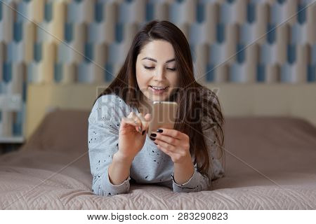 Technology, People, Communication And Rest Concept. Pleased Young Woman With Dark Straight Hair, Hol