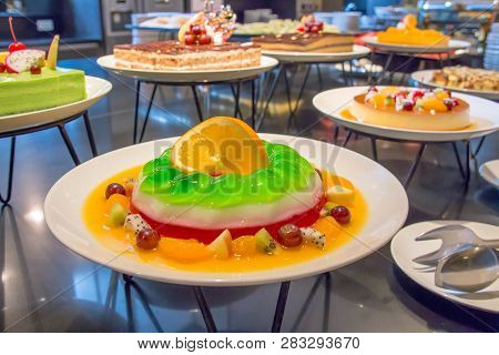 A Jelly With Fruit White Plate For Buffet