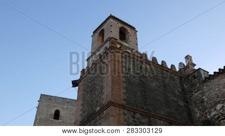 Medieval Tower Of Alora Arabic Castle Against Blue Winter Sky In Andalusia