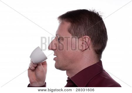 Man Is Drinking A Cup Of Coffee