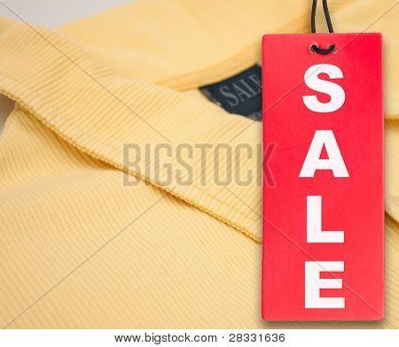 Sale Tag And Polo Shirt