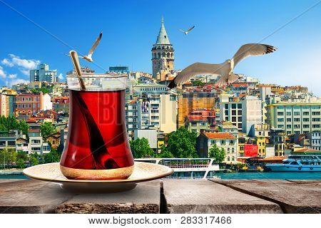 Tea And Galata Tower In Golden Horn Bay, Turkey
