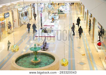 St. Petersburg, Russia - Dec 12, 2018: People Walking In Shopping Mall. Interior And Shop Windows, C