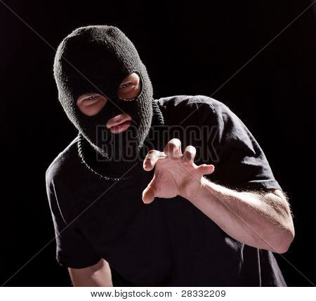 Aggressive Burglar In Black Mask
