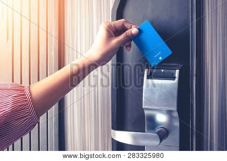 Hand Inserting Key Card To Unlock A Door Security Authentication In The Hotel Or Apartment Safeguard