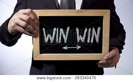 Win-win Written On Blackboard, Businessman Holding Sign, Business Concept