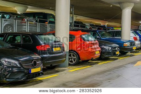 Cars Parked In A Indoor Parking Garage, Long Row Of Cars, Commercial Parking Lot