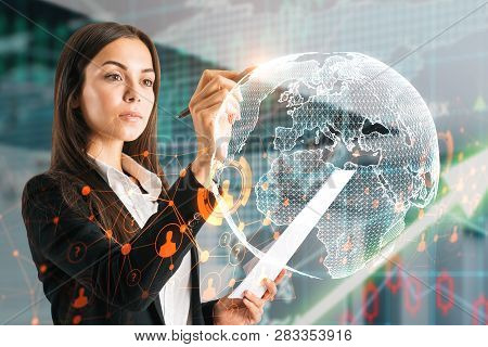 Side View Of Attractive Young European Businesswoman Using Abstract Globe Interface Om Blurry Backgr