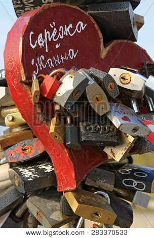 Krasnodar, Russia - March 29, 2008: Locking Padlocks With Written Names Of Just Married Couple And T
