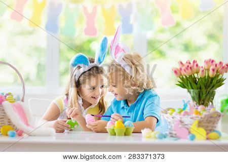 Kids On Easter Egg Hunt. Children Dye Eggs.