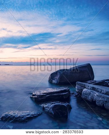 Rocky Coastline Sunset. Blue Hour On Lake Michigan At Peninsula State Park, Door County, Wisconsin