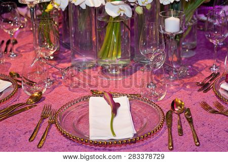 Detail of a wedding dinner setting in pink