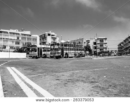 Bugibba, Malta - June 14, 2005: The Red And Orange Coloured Retro-styled Maltese Public Buses Stay A