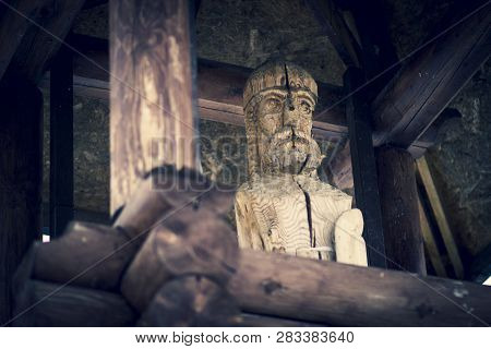 Wooden Russian watchful sentry on patrol guard wooden tower in Russian city