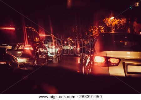 Cars In The Night Traffic Jam . Looking Behind The Cars. Cars Are Red, Yellow Night Light. Night Roa