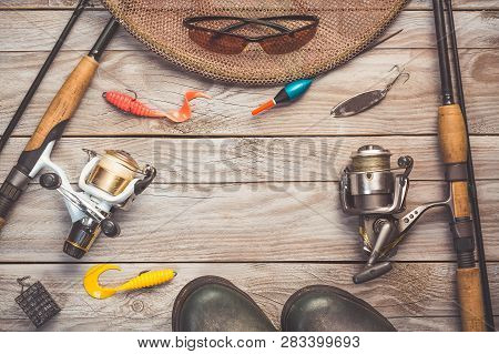 Fishing Background Theme. Fishing Rods With Reels, Fishing Tackles, Rubber Boots, Fishing Buoy And P