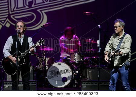 HUNTINGTON, NY - FEB 8: (L-R) Dewey Bunnell, Rylan Steen and Gerry Beckley of America perform in concert at the Paramount on February 8, 2019 in Huntington, New York.