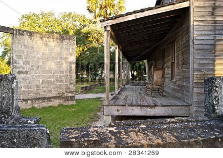 Old Wooden Home And Broken Wall