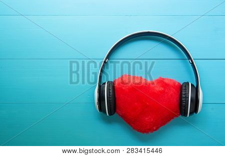 Headphones And Heart Shape Listening Music On Blue Wooden Background, Earphone With Audio Radio, Val