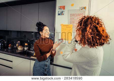 Two roommates speaking about their obligations in cleaning poster