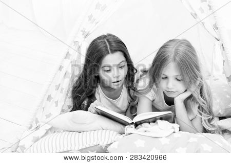 Girls Best Friends Read Fairy Tale Before Sleep. Best Books For Kids. Children Read Book In Bed. Rea