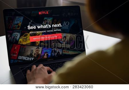 Bangkok, Thailand - March 11, 2019 : Women Use Netflix App On Laptop Screen. Netflix Is An Internati