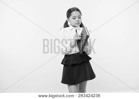 Child School Uniform Smart Kid Hold Textbook. Girl Happy Face Carry Textbook Yellow Background. Chil