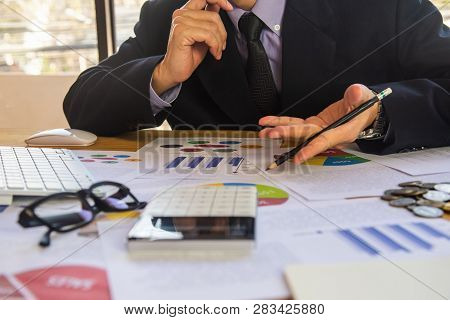 poster of Accountant working on calculator to calculate accounting and business finance plan sales. Business accounting, business investment advisor consulting on the financial report, plan a marketing plan at business office. Business accounting plan concept.