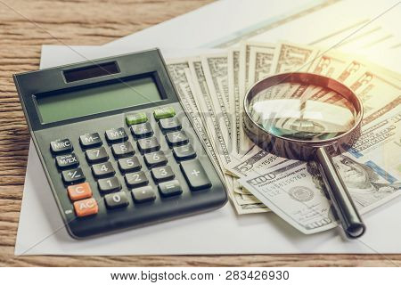 Tax, Search For Return Or Financial Report Review Concept, Magnifying Glass On Pile Of Us Dollar Ban