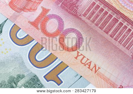 Closed Up Of 100 Us Dollar Banknote Number On Red 100 Chinese Yuan Banknote, Currency Exchange Or Tr