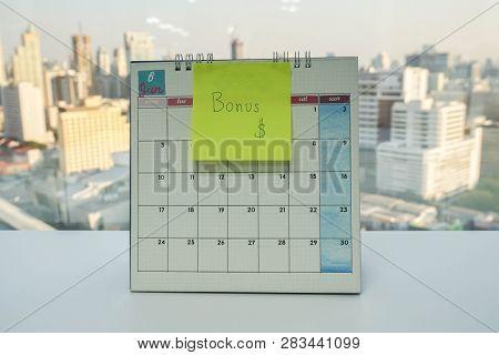 Postit Of Yearly Bonus On June Calendar In Office