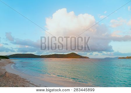 A Huge Cumulus Cloud Over Sandy Beach On Tropical Island At Sunset. Beautiful Tranquil Landscape Of
