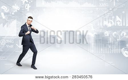 Young suited karate trainer doing karate tricks on the top of a metropolitan city