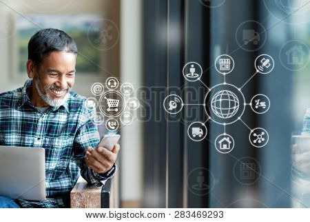 Asian Or Hispanic Man Using Smartphone Mobile Payment Shopping Online With Icon Customer Network Con