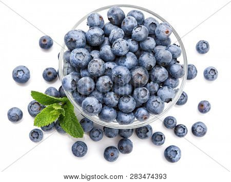 Berry blueberry with leaf mintclose-up. Fruity still life for organic healthy food, isolated on white background, Top view.