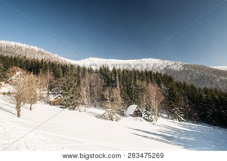 Frozen Lysa Hora Hill From Butoranka With Few Chalets Above Ostravice Village During Freezing Winter