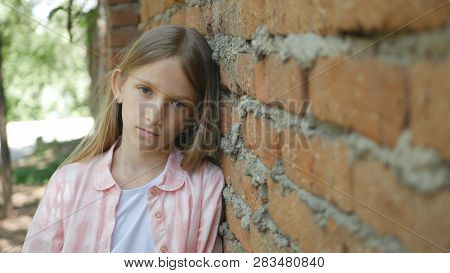 Sad Unhappy Child Looking in Camera, Bored Girl Portrait, Miserable Kid Face poster