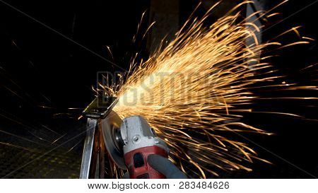 Spark On Dark Background. Production Of Metal Structures. Enterprise Processing Metal. Processing Of