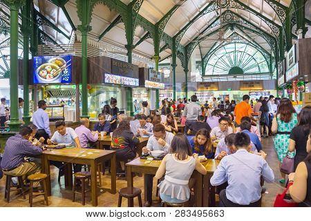 Singapore - Jan 16, 2017 : People At Popular Food Court In Singapore. Inexpensive Food Stalls Are Nu