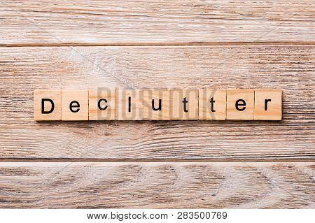 Declutter Word Written On Wood Block. Declutter Text On Wooden Table For Your Desing, Concept