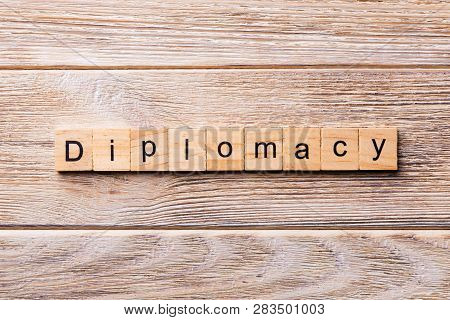 Diplomacy Word Written On Wood Block. Diplomacy Text On Wooden Table For Your Desing, Concept