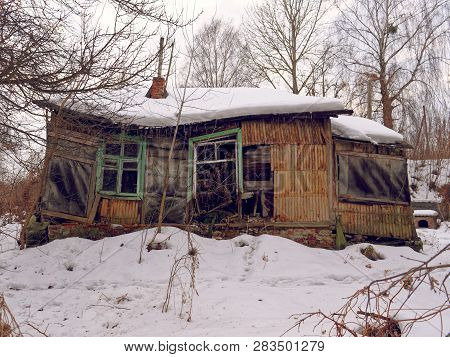 Gomel, Belarus. Abandoned Wooden House With Farmstead.