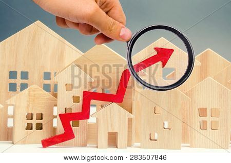 The Concept Of Real Estate Market Growth. The Increase In Housing Prices. Rising Prices For Utilitie