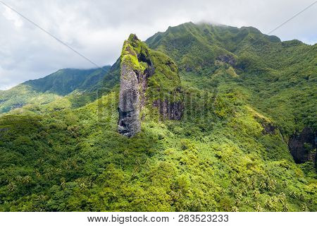 Cliff In The Shape Of A Giant Tiki Head On Raiatea Island. Raiatea, Leeward Islands, Society Islands