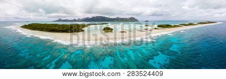 Aerial View Of Raivavae Island With Sandy Beaches, Coral Reef And Green Islets Motu In Azure Turquoi