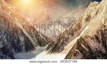 High Mountains With Falling Snow